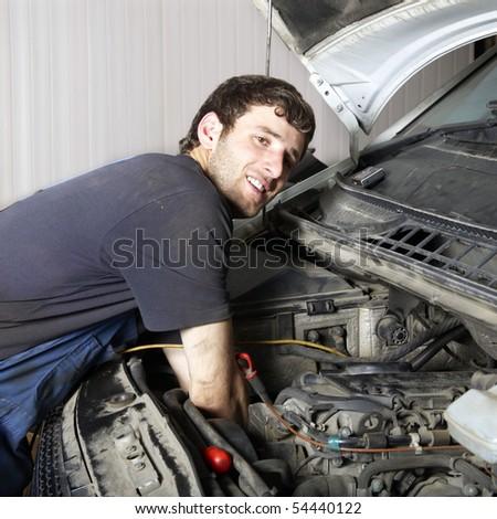 auto mechanic repairing a car engine