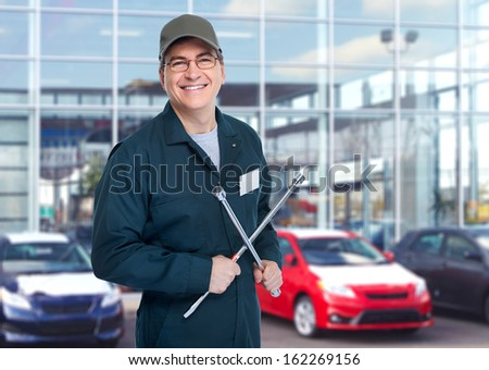 Auto mechanic with wrench Car repair service