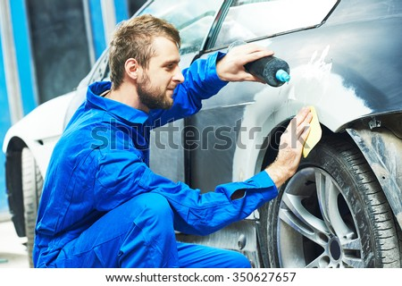 Shutterstock auto mechanic worker applying washing car body preparing for painting at automobile repair and renew service station