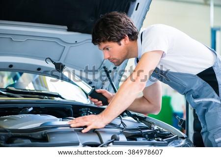 Auto mechanic working in car service workshop #384978607