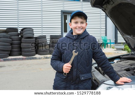 Auto mechanic working in garage. Car service. Repair service.