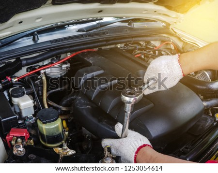 auto repair in the auto shop by hand tools #1253054614