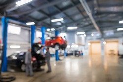 Auto repair shop in bokeh, defocused background