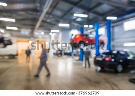 Auto repair shop in bokeh, defocused background