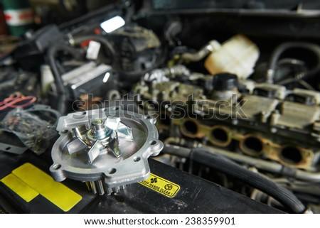 auto repair spare part turbine during automobile car maintenance at engine repair service station garage