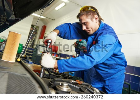 auto repairman industry mechanic worker in car auto repair or maintenance shop service station