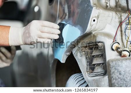 auto repairman plastering autobody bonnet #1265834197