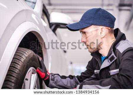 Auto Service Job. Automotive Industry Theme. Caucasian Car Technician Taking Close Look Into Issue. #1384934156