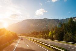 Autobahn in austrian mountains at sunset