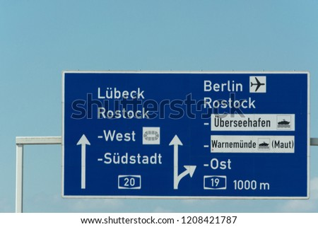 Autobahn sign in Germany Caption on German - city names Berlin,Berlin Airport, Rostock, Lübeck