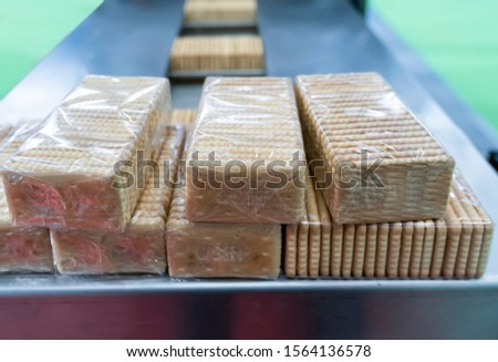automate robot conveyor in Production of biscuits in a manufacture factory for the food industry