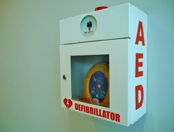 automated external defibrillator on white wall