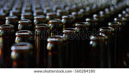 Shutterstock Automated industrial chain of bottles for beer and alcoholic and soft drinks. The concept of industry and sectors of automation and robots.