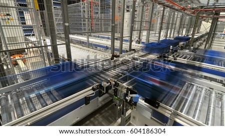 Automated roller conveyors with moving totes
