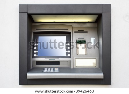 Automated teller machine close up on a wall