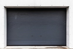 Automatic black roller shutter doors on the ground floor of the house