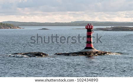Automatic lighthouse on a small island in the archipelago of the Aland Islands, Finland