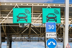 automatic point of payment on a toll road. turnpike.area pay tolls on the toll road.Urban highway.speed limit, board sign of automatic paying lanes, non-stop driving symbol.