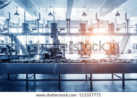 Automatic production line in the factory packing workshop, blue tint map. #515337775