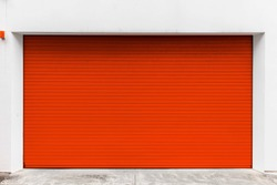 Automatic red roller shutter doors on the ground floor of the house