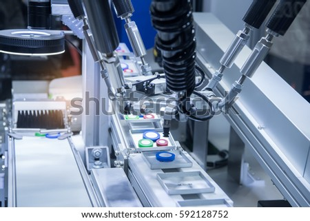 Shutterstock Automatic robot in assembly line working in factory. Smart factory industry 4.0 concept.