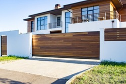 Automatic sliding doors with wood texture in the cottage