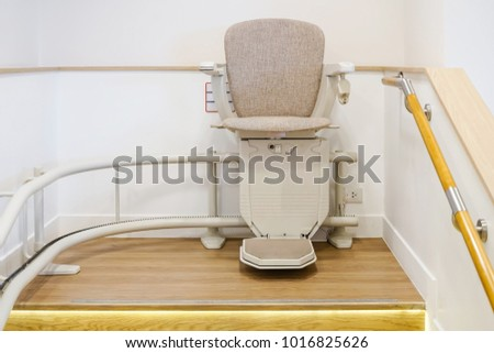 Automatic stair lift on staircase for elderly people and disabled persons #1016825626