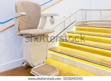 Automatic stair lift on staircase for elderly people and disabled persons #1018243141