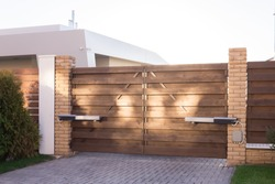 Automatic swing gates made of wood in a private house