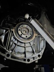 Automatic transmission close-up in a car repair shop.