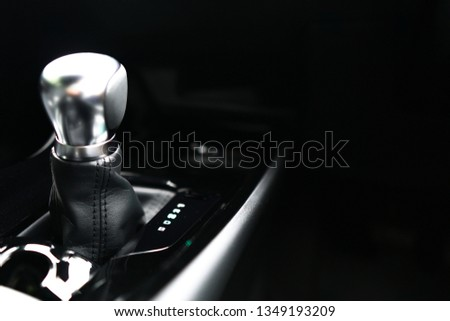 Automatic transmission gear on dark background.Modern new car interior,Close up of metallic silver Gearstick.Technology,Vehicle,Automobile Concept.