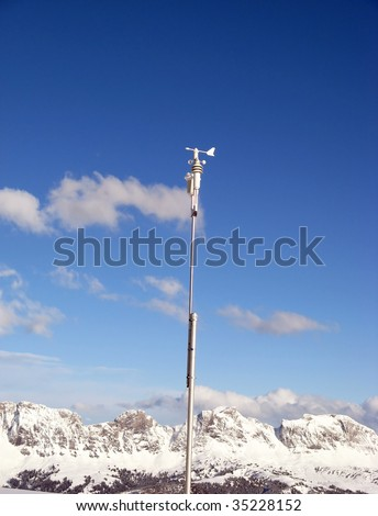 Automatic weather station against blue sky