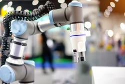 Automation concept: View of electric gripper on universal robot arm.