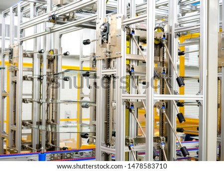 Automation concept: View of wind shield stacking unit in automatic glass sealing machine in automotive assembly plant