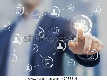 Automation of business workflows and processes with a businessman in background touching a button