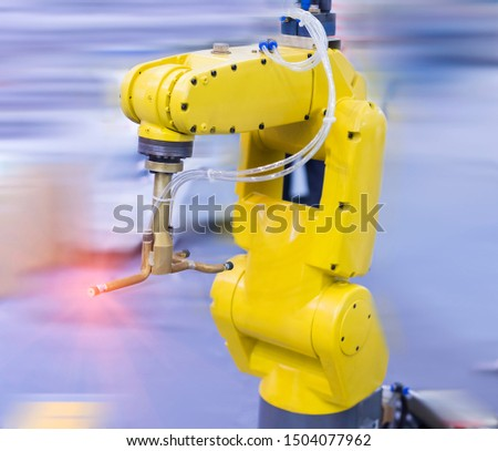 Automation system control application on automate robot arm in smart manufacturing background.