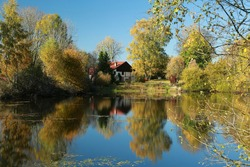 automn colors and waterreflection landscape in France