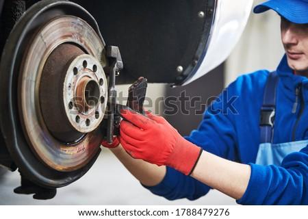 Automobile brake pads replacement in car repair shop or garage Сток-фото ©