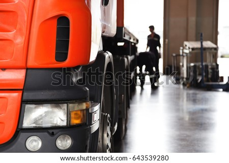 automobile mechanic checking truck in the garage, selective focus.