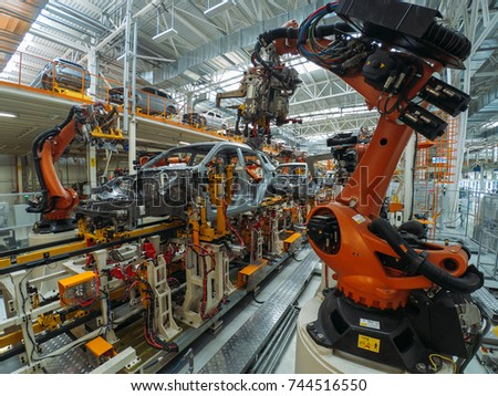 Automobile plant, welding process, modern production of cars, robot equipment, automated production line. #744516550