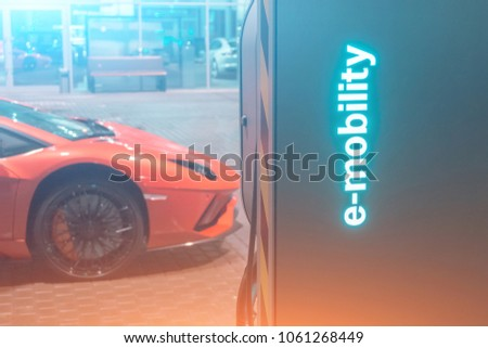 Automobile refueling for electric cars e-mobility in the background super car, wheel #1061268449