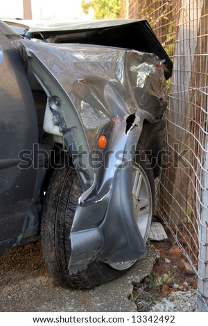 Automobile with front end badly damaged after a collision with another car