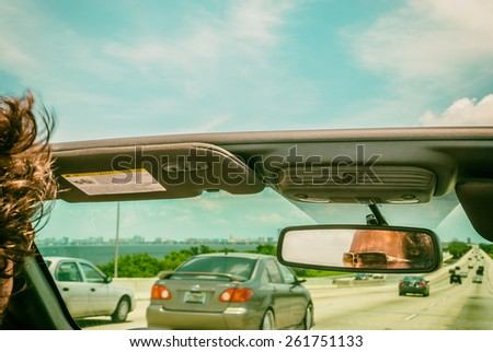 stock-photo-automobiles-on-highway-young-man-wearing-sunglasses-vintage-filter-image-male-car-driver-in-open-261751133.jpg