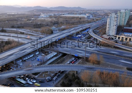 Automobiles trip traffic.Road shot - city cars traffic in Beijing China