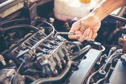 Automotive center mechanic man auto mibile car service repair garage autocar vehicles service mechanical man engineering. Automobile mechanical close up hands fixing car repairing technician mechanic