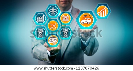 Automotive executive forecasting market growth for electric vehicles running on renewable energy sources following declining cost of electricity storage technologies. Concept for sustainability. #1237870426