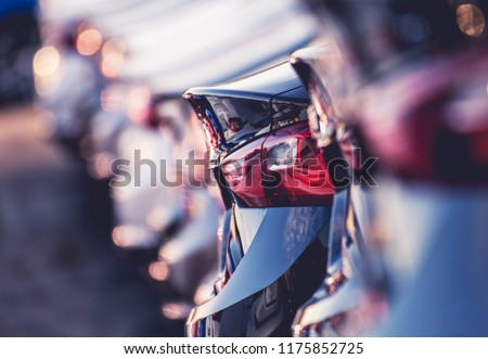 Automotive Industry Business Concept Photo. New and Used Cars on the Dealer Lot.
