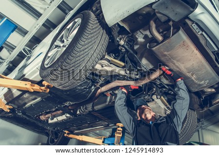 Automotive Mechanic Job. Caucasian Auto Service Worker and the Vehicle Maintenance. #1245914893