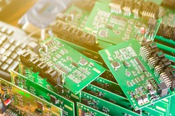 Automotive Printed Circuit Boards with Surface Mounted Components with PCBs On Top of Boards. Lens Flares Added. Horizontal Image Orientation