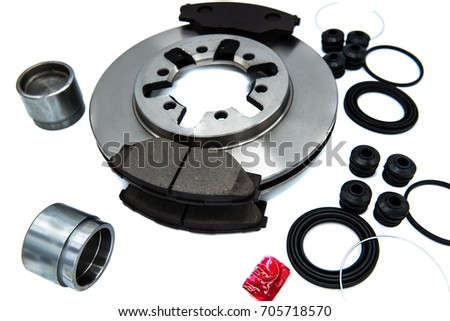 Automotive Spare Parts of disk brake pads, disc brake caliper piston, disk brake repair kIt and rotating brake disk on white background. #705718570